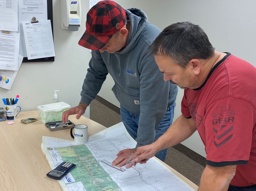 Project Managers reviewing plans