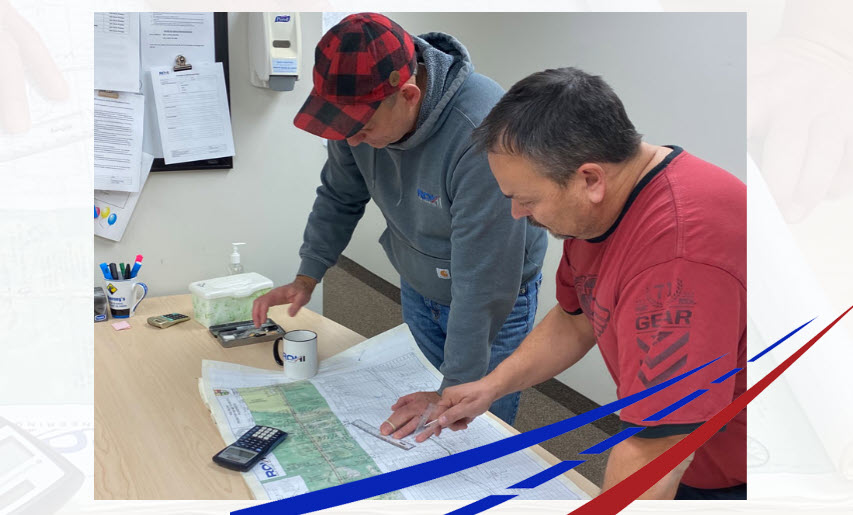 Randall Trites and Glen Sandin reviewing engineering project
